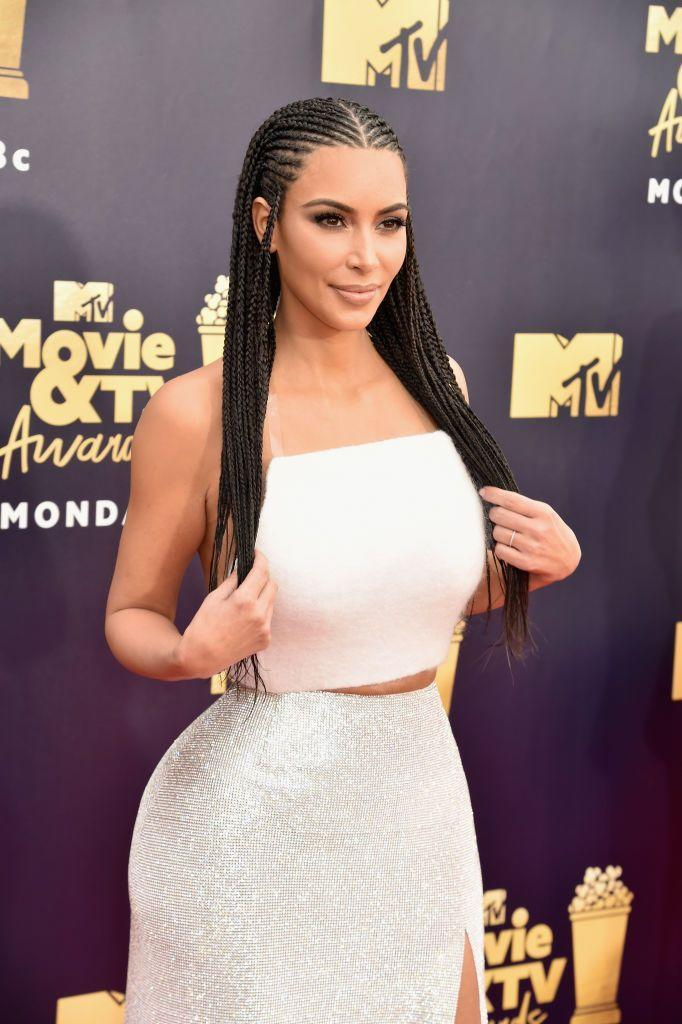 """<p>Kim Kardashian has gotten <a href=""""https://www.yahoo.com/lifestyle/heres-real-problem-kim-kardashians-bo-derek-braids-173351058.html"""" data-ylk=""""slk:lots of flak;outcm:mb_qualified_link;_E:mb_qualified_link;ct:story;"""" class=""""link rapid-noclick-resp yahoo-link"""">lots of flak</a> over the years for styling her hair in Fulani braids, or cornrows, a traditionally Black hairstyle. In 2018, Kardashian West responded to controversy over her referring to her blonde braids as """"Bo Derek braids."""" """"I know the origin of where they came from and I'm totally respectful of that,"""" she <a href=""""https://www.bustle.com/p/kim-kardashian-explains-why-she-wears-fulani-braids-despite-all-the-internet-backlash-9505337"""" rel=""""nofollow noopener"""" target=""""_blank"""" data-ylk=""""slk:told Bustle"""" class=""""link rapid-noclick-resp"""">told Bustle</a>. """"I'm not tone deaf...I do get it."""" She also came under fire again in 2019 for <a href=""""https://edition.cnn.com/style/article/kim-kardashian-kimono-intl-scli/index.html"""" rel=""""nofollow noopener"""" target=""""_blank"""" data-ylk=""""slk:naming her shapewear line"""" class=""""link rapid-noclick-resp"""">naming her shapewear line</a> Kimono. </p>"""