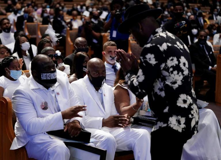 Singer Ne-Yo (R) pays respects to the Floyd family at The Fountain of Praise Church on June 9, 2020, in Houston (AFP Photo/David J. Phillip)