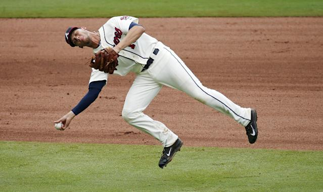 Atlanta Braves shortstop Andrelton Simmons throws after fielding a ball hit for a single by Philadelphia Phillies' Marlon Byrd in the seventh inning of a baseball game in Atlanta, Sunday, July 20, 2014. Atlanta won 8-2. (AP Photo/John Bazemore)