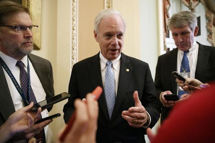 Sen. Ron Johnson, R-Wis., speaks to reporters, Monday, Jan. 27, 2020, on Capitol Hill in Washington, about the impeachment trial of President Donald Trump on charges of abuse of power and obstruction of Congress. (AP Photo/ Jacquelyn Martin)