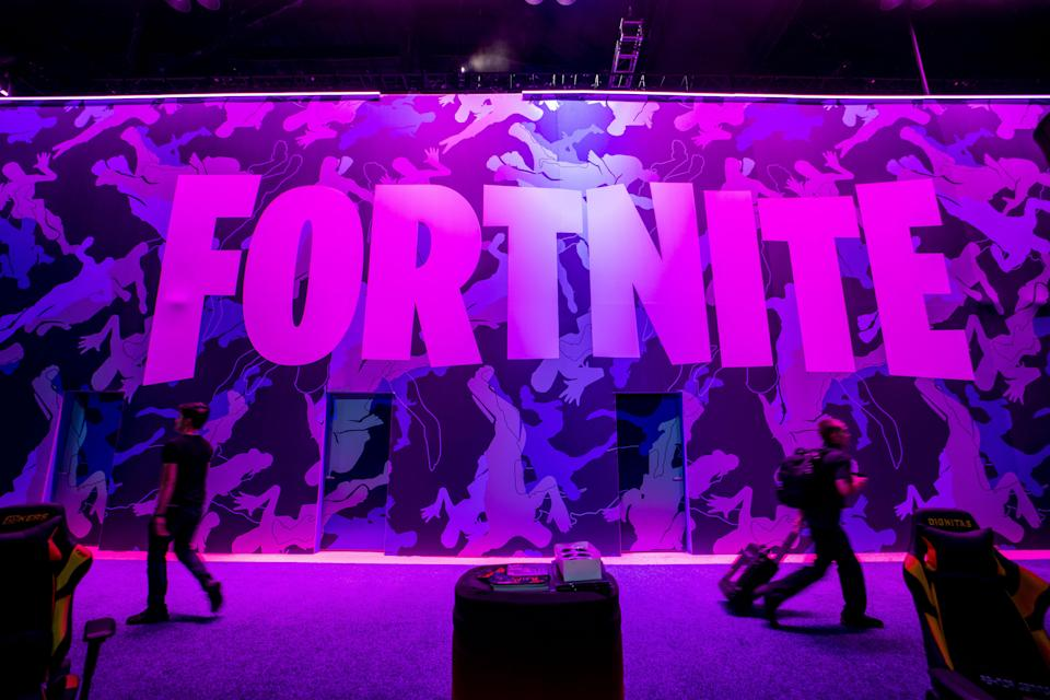 Attendees walk past signage for Epic Games Inc. Fortnite video game during the E3 Electronic Entertainment Expo in Los Angeles, California, U.S., on Wednesday, June 12, 2019. For three days, leading-edge companies, groundbreaking new technologies and never-before-seen products are showcased at E3. Photographer: Kyle Grillot/Bloomberg via Getty Images