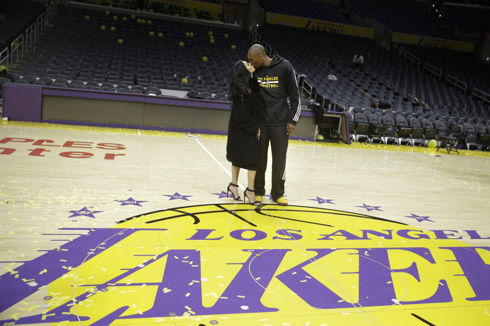 Los Angeles Lakers forward Kobe Bryant kisses his wife, Vanessa, after the last NBA basketball game of his career, against the Utah Jazz, on Thursday, April 14, 2016, in Los Angeles.