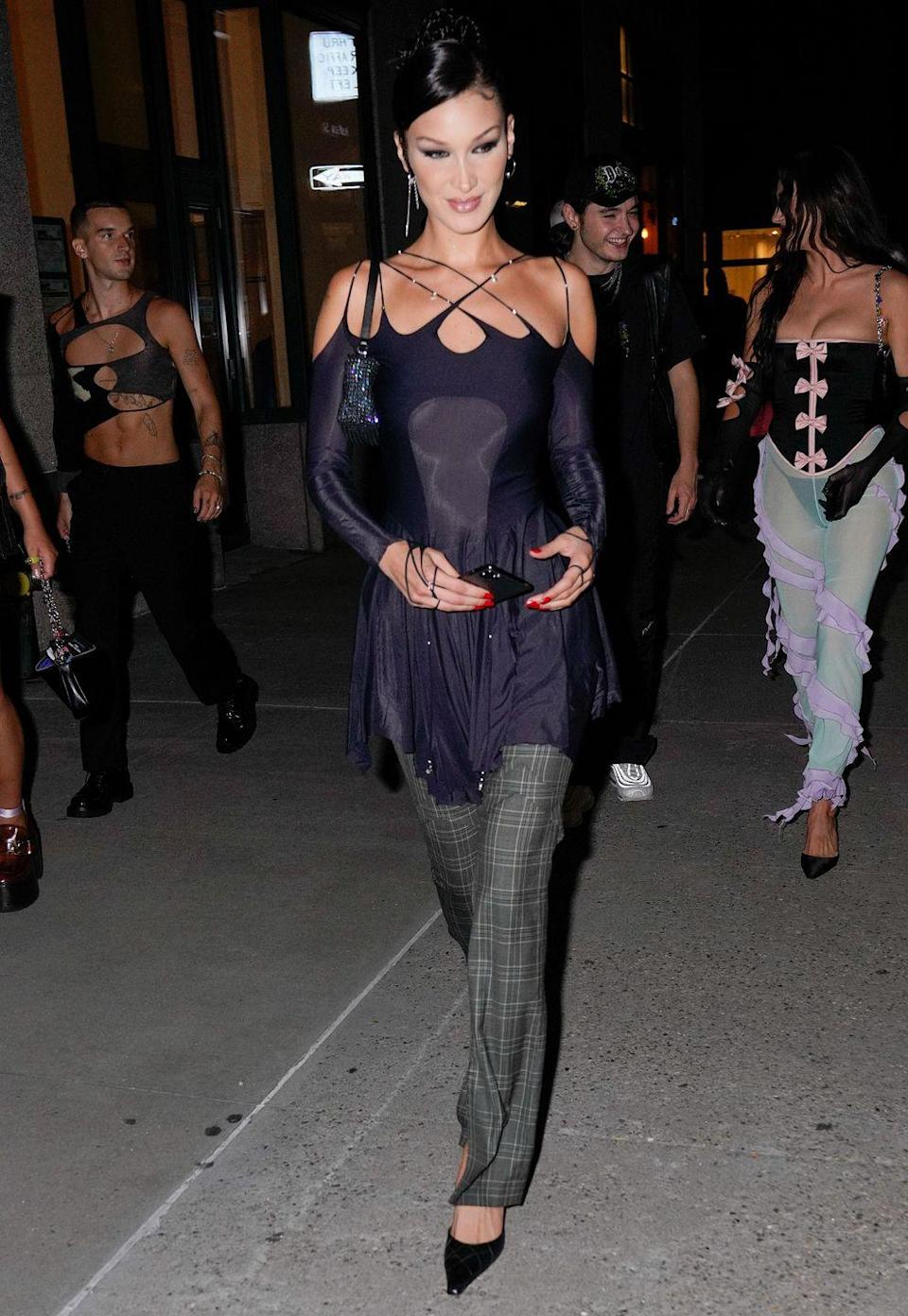 <p><strong>8 September</strong></p><p>Bella Hadid teamed her cut-out top with checked trousers.</p>
