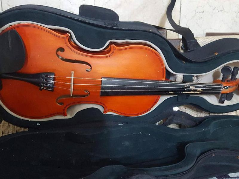 'He loved the violin so much, he didn't let it go even when he drowned'