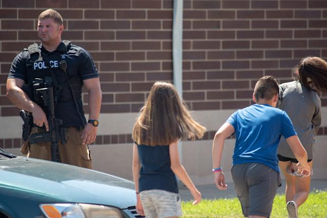 <p>Police asses the scene outside Noblesville High School after a shooting at Noblesville West Middle School on May 25, 2018 in Noblesville, Ind. (Photo: Kevin Moloney/Getty Images) </p>