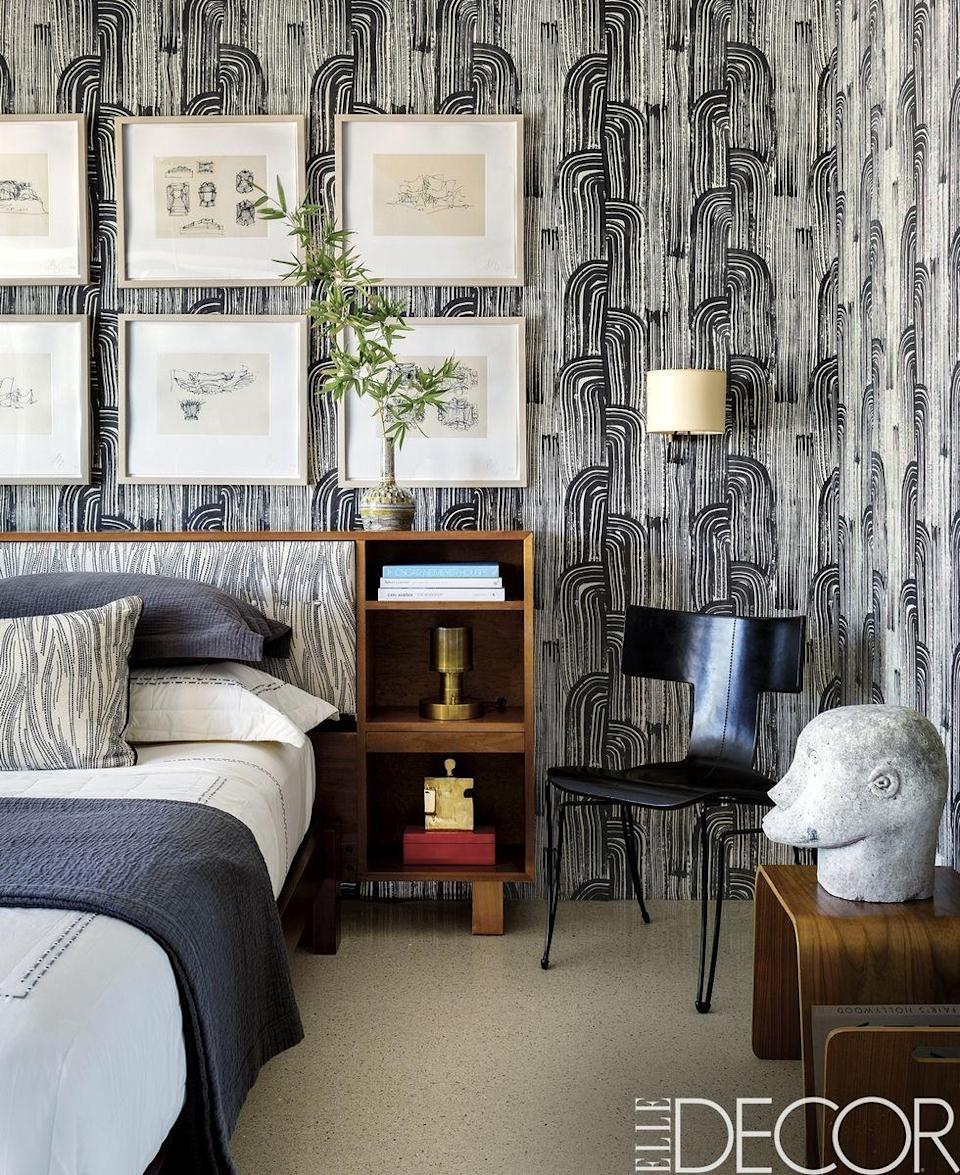 """<p>Inside a <a href=""""https://www.elledecor.com/design-decorate/house-interiors/a8712593/palm-springs-house/"""" rel=""""nofollow noopener"""" target=""""_blank"""" data-ylk=""""slk:Palm Springs home"""" class=""""link rapid-noclick-resp"""">Palm Springs home</a>, the guest room's eye-catching wallpaper is a <a class=""""link rapid-noclick-resp"""" href=""""http://www.kellywearstler.com/"""" rel=""""nofollow noopener"""" target=""""_blank"""" data-ylk=""""slk:Kelly Wearstler design"""">Kelly Wearstler design</a>, punctuated by <a class=""""link rapid-noclick-resp"""" href=""""http://www.biography.com/people/frank-gehry-9308278"""" rel=""""nofollow noopener"""" target=""""_blank"""" data-ylk=""""slk:Frank Gehry"""">Frank Gehry</a> drawings and a sleek black chair by <a class=""""link rapid-noclick-resp"""" href=""""https://www.donghia.com/"""" rel=""""nofollow noopener"""" target=""""_blank"""" data-ylk=""""slk:Donghia"""">Donghia</a>.</p><p><em>Crescent Wallpaper, $652</em><br><a class=""""link rapid-noclick-resp"""" href=""""https://go.redirectingat.com?id=74968X1596630&url=https%3A%2F%2Fwww.houzz.com%2Fproduct%2F41878274-crescent-wallpaper-ebony-cream-contemporary-wallpaper&sref=https%3A%2F%2Fwww.redbookmag.com%2Fhome%2Fg35083191%2Fwallpaper-design-ideas%2F"""" rel=""""nofollow noopener"""" target=""""_blank"""" data-ylk=""""slk:Shop the Look"""">Shop the Look</a></p>"""