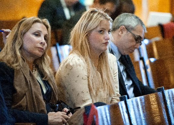 This Sept. 23, 2013 photo, Samantha Perelman, daughter of billionaire Ronald Perelman, and granddaughter of the late Hudson News patriarch Robert Cohen, center, looks on during opening arguments in her lawsuit against the Cohen family in Superior Court in Hackensack, N.J. Samantha Perelman claims her uncle, James Cohen,, systematically squeezed her out of her grandfather's will during the last several years of Robert Cohen's life as he suffered from the debilitating effects of a Parkinson's-like disease before dying in 2012. (AP Photo/The Record of Bergen County, Amy Newman, Pool)