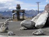 """This photo taken Thursday, March 18, 2021 in Fernley, Nev. shows sculptures of a desert tortoise and a flower made out of bottle caps. The town was founded about 30 miles east of Reno a century ago after the first major irrigation project in the West was built to """"make the desert bloom."""" The city is suing the U.S. government over plans to renovate an earthen irrigation canal that burst and flooded nearly 600 homes in Fernley in 2008. (AP Photo/Scott Sonner)"""