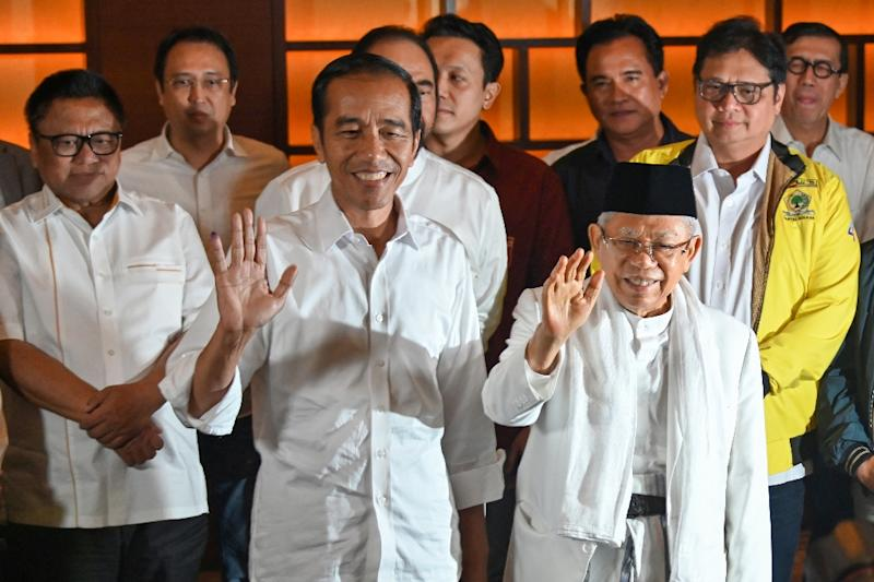 Indonesian President Joko Widodo (C) looks set for a second term after unofficial 'quick count' results gave him a 9-11 point lead