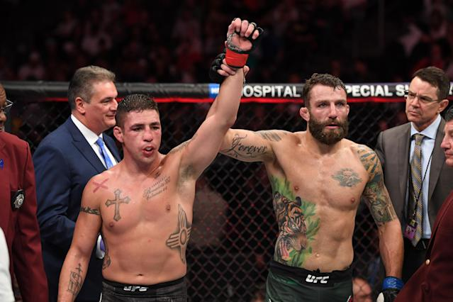 Michael Chiesa raises the hand of Diego Sanchez in their welterweight fight during the UFC 239 event at T-Mobile Arena on July 6, 2019 in Las Vegas, Nevada. (Getty Images)
