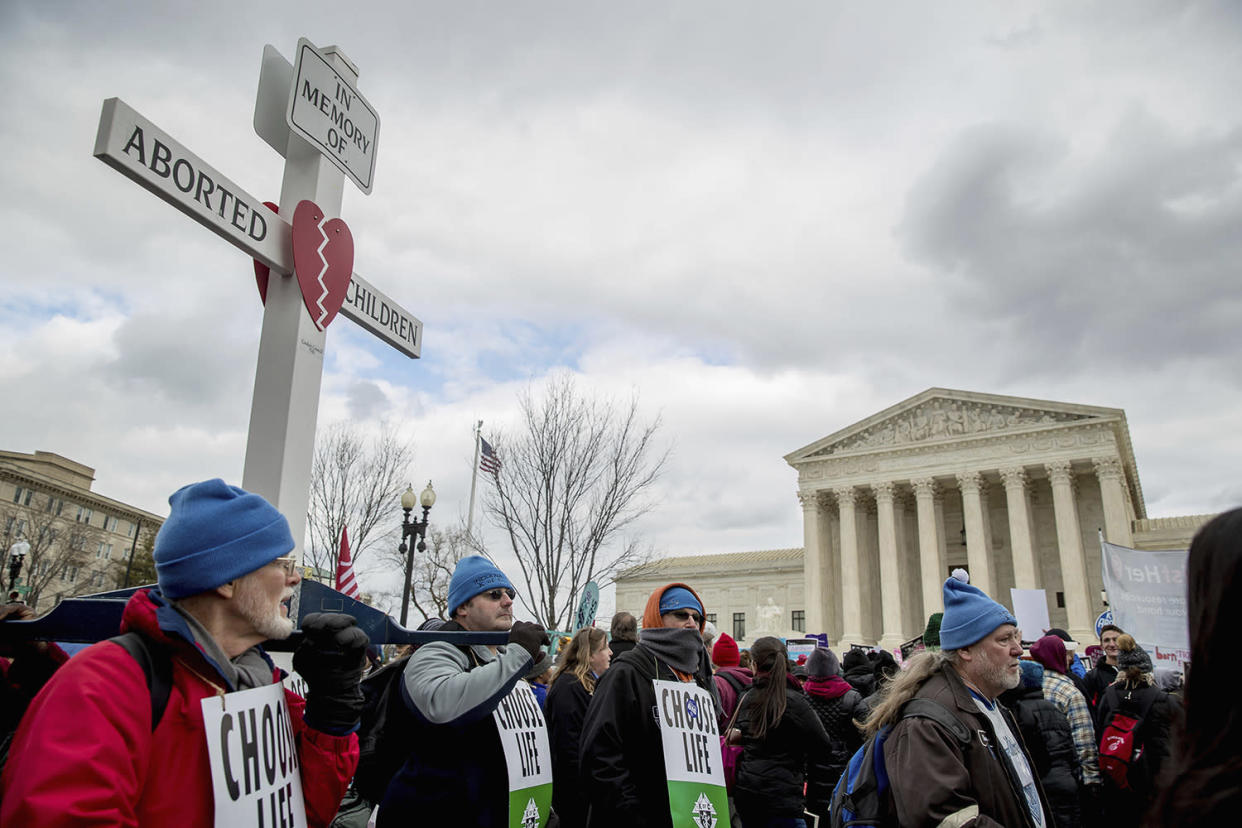 Pro-life activists converge in front of the Supreme Court in Washington during the annual March for Life on, Friday, Jan. 27, 2017. Thousands of anti-abortion demonstrators gathered in Washington to protest the Supreme Court's landmark 1973 decision, which declared a constitutional right to abortion. (Photo: Andrew Harnik/AP Photo)
