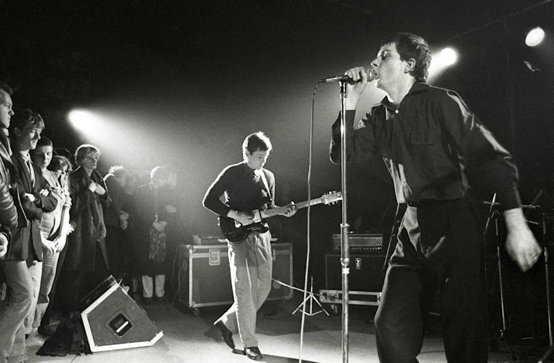 NETHERLANDS - JANUARY 16: ROTTERDAM Photo of Joy Division performing live in Rotterdam, Bernard Sumner (left) & Ian Curtis (Photo by Rob Verhorst/Redferns)