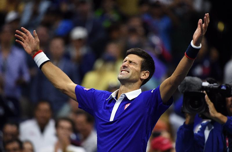 Novak Djokovic celebrates after defeating Roger Federer at the US Open final at Arthur Ashe Stadium in New York on September 13, 2015 (AFP Photo/Jewel Samad)