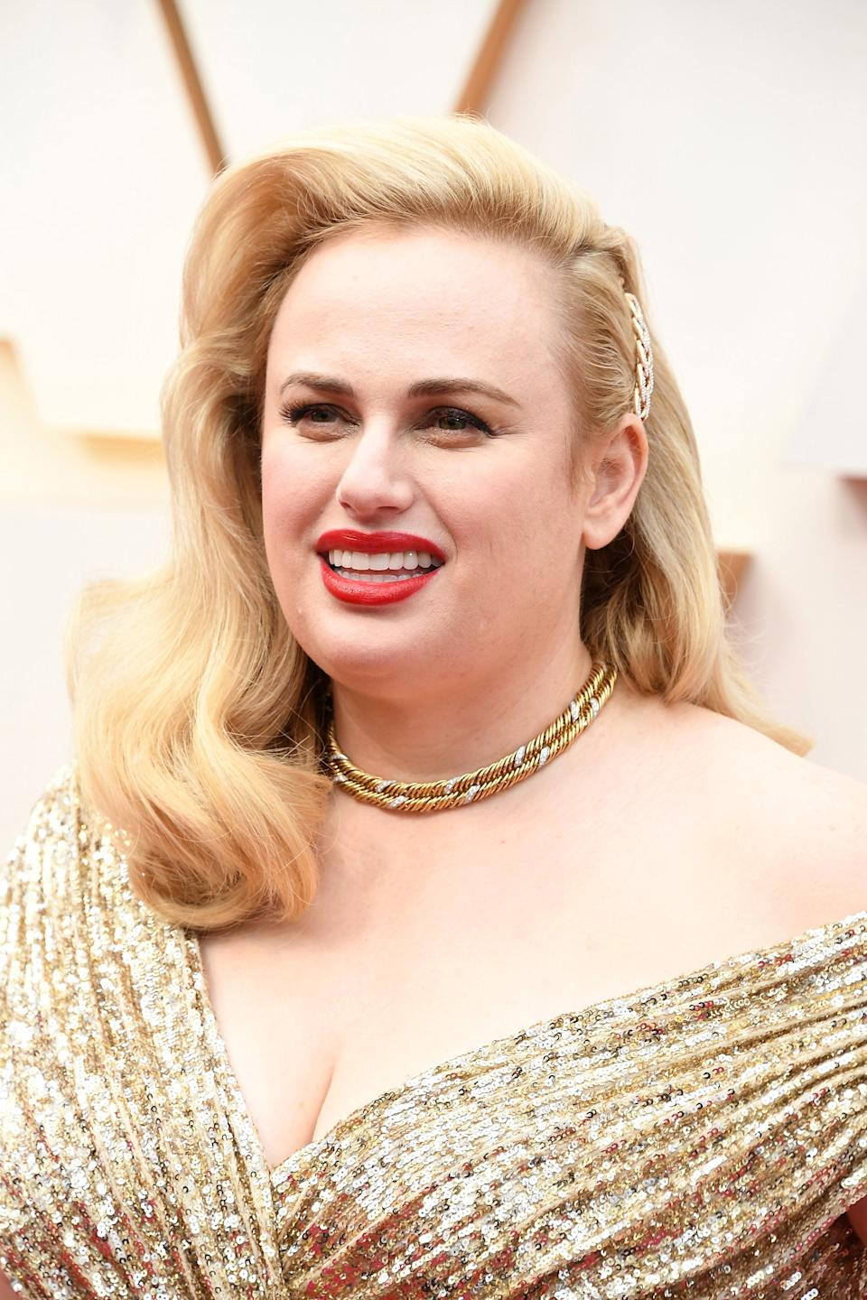 """Rebel Wilson's old-Hollywood waves were given the Kitsch treatment by her hairstylist Robert Vetica.<span class=""""copyright"""">Photo: Steve Granitz/WireImage.</span>"""