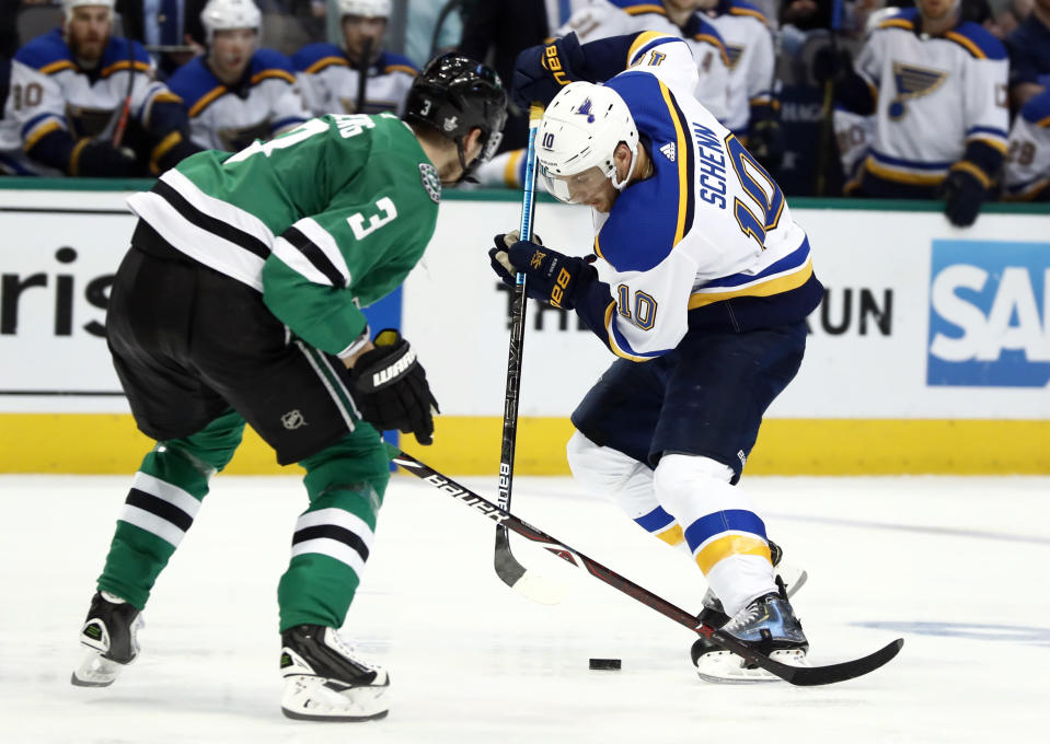 St. Louis Blues' Brayden Schenn (10) brings the puck down the ice as Dallas Stars' John Klingberg (3), of Sweden, defends during the second period in Game 6 of an NHL second-round hockey playoff series, Sunday, May 5, 2019, in Dallas. (AP Photo/Tony Gutierrez)