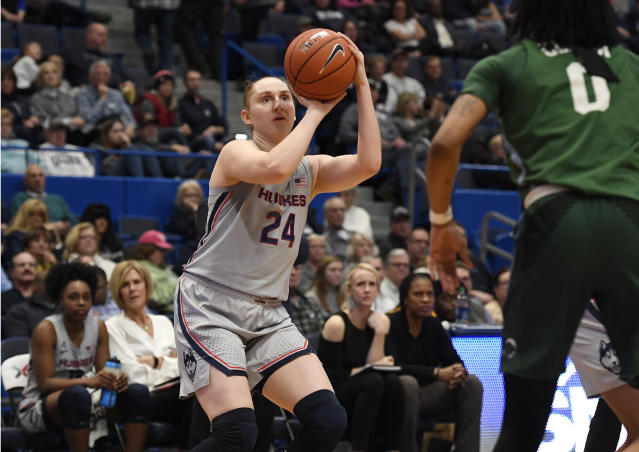 Connecticut's Anna Makurat (24) shoots over Tulane's Arsula Clark (0) in the second half of an NCAA college basketball game, Wednesday, Feb. 19, 2020, in Hartford, Conn. (AP Photo/Jessica Hill)