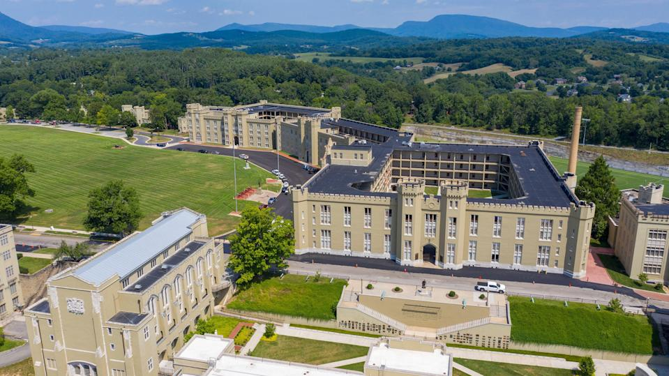 The barracks, right, and chapel, left, at Virginia Military Institute Wednesday July 15, 2020, in Lexington, Virginia. The school founded in 1839, is the oldest state-supported military college in the United States. ((AP Photo/Steve Helber))