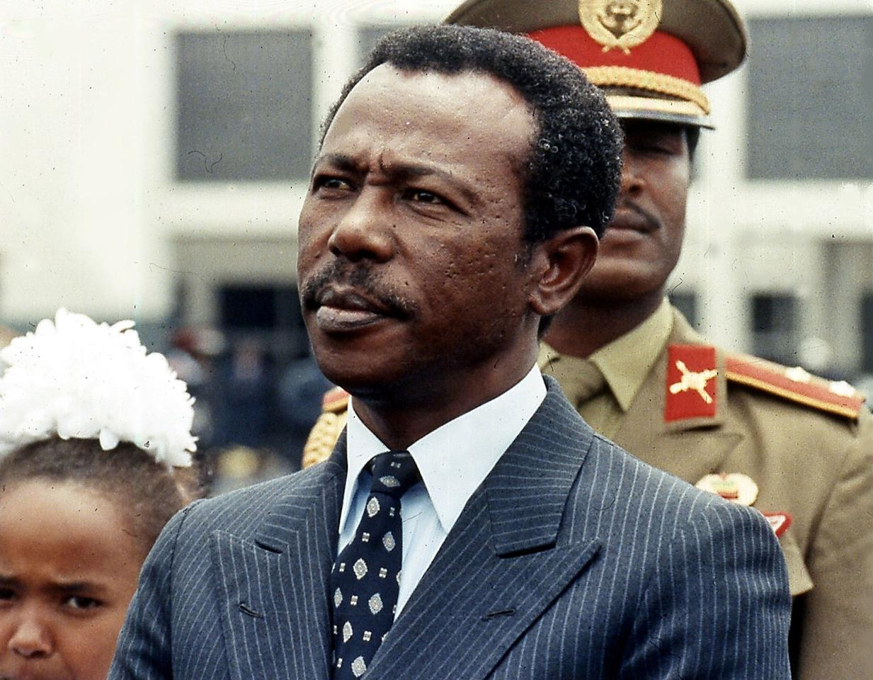 "** FILE ** Former Ethiopian president Mengistu Haile Marian, is seen in Ethiopia, in this Aug. 9, 1990 file photo. Mariam, the Ethiopian dictator who directed the ""Red Terror"" against supposed enemies of his Soviet-backed regime, was convicted Tuesday, Dec. 12, 2006, of genocide in a rare case of an African strongman being called to account by his own country. Mengistu has been living in exile in Zimbabwe since 1992 and was convicted in absentia after a 12-year trial. He could face the death penalty at his Dec. 28 sentencing, but Zimbabwean President Robert Mugabe said he won't deport Mengistu if he refrains from making political statements or comments to the press.(AP Photo/Aris Saris)"
