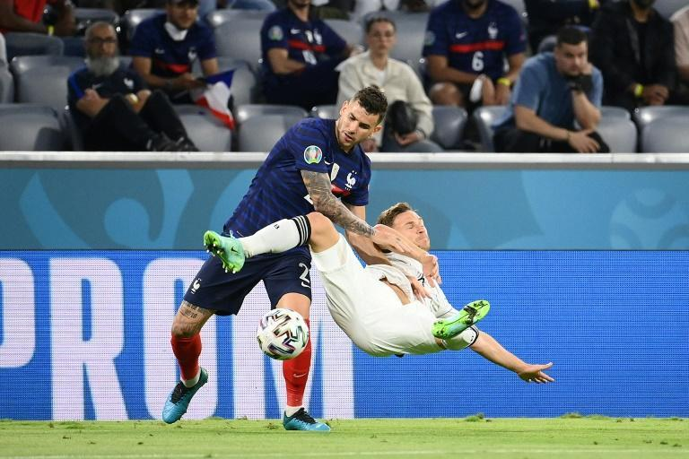 Joshua Kimmich (R) battles with his French Bayern Munich team-mate Lucas Hernandez (L) at the Euro 2020 finals