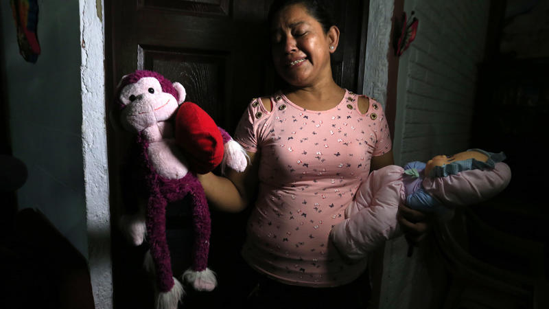 Rosa Ramirez sobs as she shows journalists toys that belonged to her nearly two-year-old granddaughter Valeria who drowned with her father while trying to cross the Rio Grande into the US from Mexico.