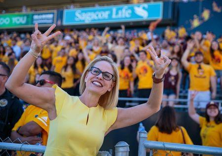 Nov 3, 2018; Tempe, AZ, USA; U.S. Representative from Arizona's 9th congressional district Kyrsten Sinema poses for a photo in front of the Arizona State Sun Devils student section prior to the game against the Utah Utes at Sun Devil Stadium. Mark J. Rebilas-USA TODAY Sports/File Photo