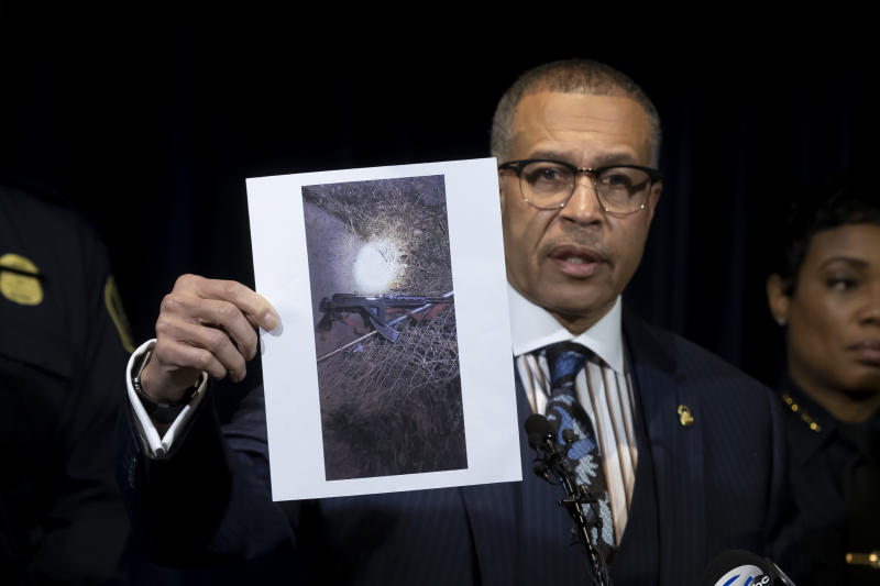 """Detroit Police Chief James Craig shows a photograph of an """"assault-type weapon"""" used by the suspect as he speaks to the media at Detroit Public Safety Headquarters Thursday, November 21, 2019, about two officers who were shot Wednesday evening while responding to a home invasion on Detroit's west side. Officer Rasheen McLain was killed during the incident and another officer was wounded.  (David Guralnick/Detroit News via AP)"""