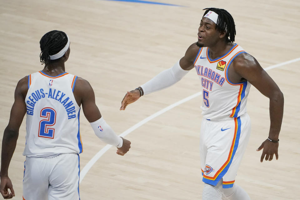 Oklahoma City Thunder forward Luguentz Dort (5) celebrates with guard Shai Gilgeous-Alexander (2) during the second half of the team's NBA basketball game against the Chicago Bulls, Friday, Jan. 15, 2021, in Oklahoma City. (AP Photo/Sue Ogrocki)