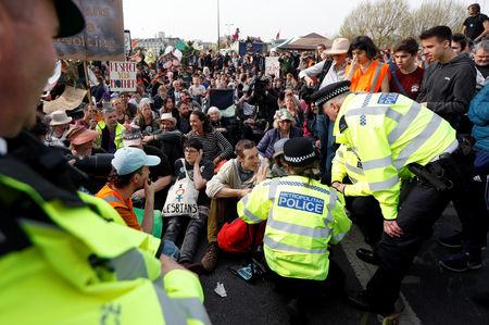 Police officers talk with climate change activists at Waterloo Bridge during the Extinction Rebellion protest in London, Britain April 18, 2019. REUTERS/Peter Nicholls