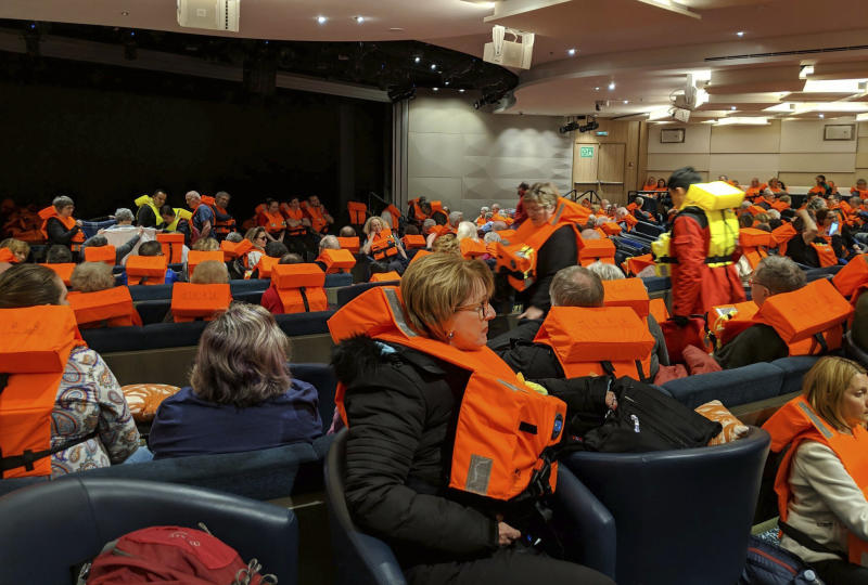<p> This photo provided by Michal Stewart shows passengers on board the Viking Sky, waiting to be evacuated, off the coast of Norway on Saturday, March 23, 2019. Rescue workers off Norway's western coast rushed to evacuate 1,300 passengers and crew from the disabled cruise ship by helicopter on Saturday, winching them one-by-one to safety as heaving waves tossed the ship from side to side and high winds battered the operation. (Michal Stewart via AP) </p>