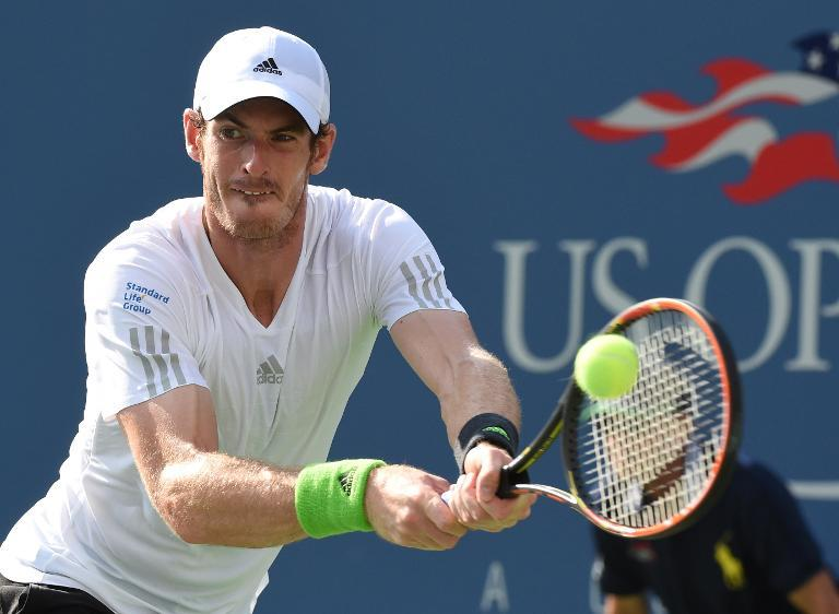 Andy Murray returns a shot against France's Jo-Wilfried Tsonga during their 2014 US Open fourth round clash on September 1, 2014 (AFP Photo/Timothy A. Clary)