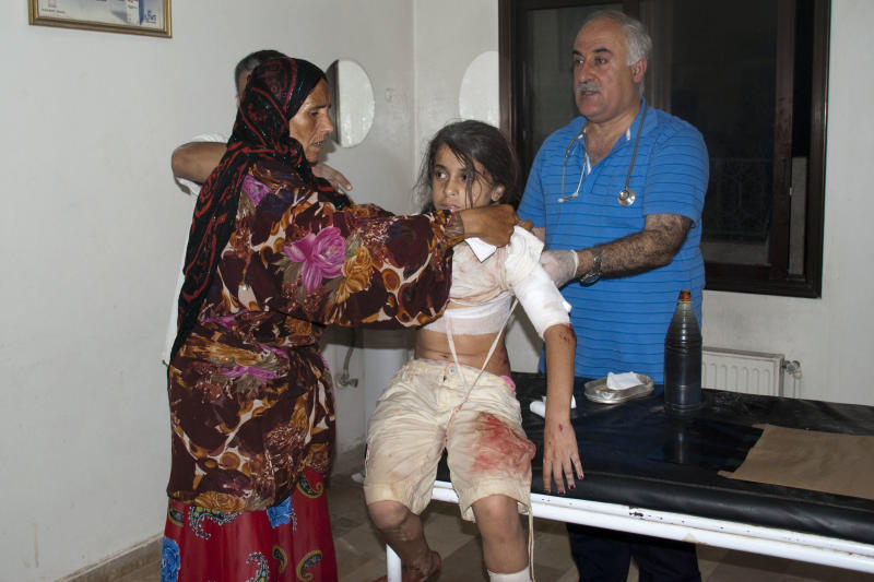 In this Friday, July 20, 2012 photo, a Syrian girl is treated for wounds suffered in shelling in Idlib, Syria. July 2012 is set to become the bloodiest month of the Syrian uprising that activists say has claimed 19,000 lives since it began on March 2011. (AP Photo/Fadi Zaidan)