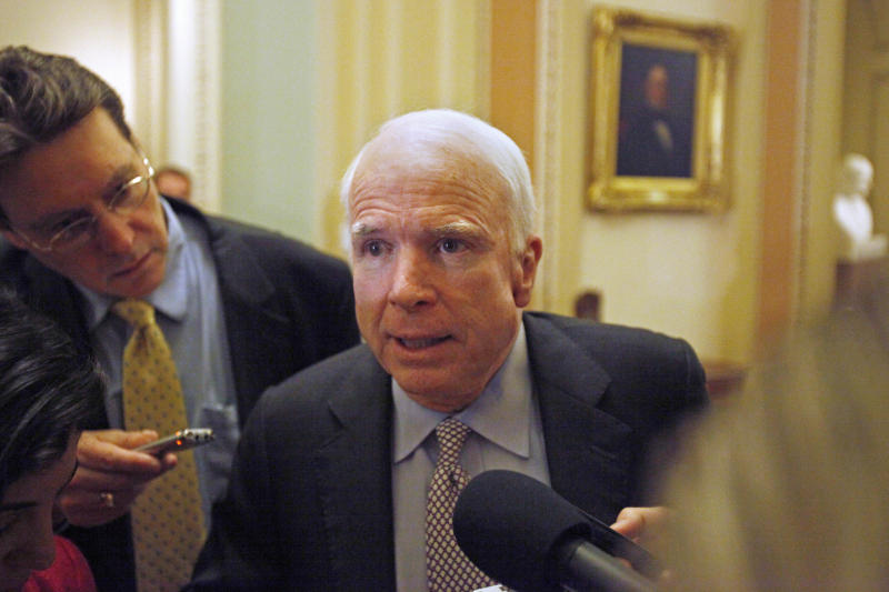 Sen. John McCain, R-Ariz., answers questions from reporters about debt ceiling legislation, Monday, Aug. 1, 2011, on Capitol Hill in Washington.  (AP Photo/Jacquelyn Martin)