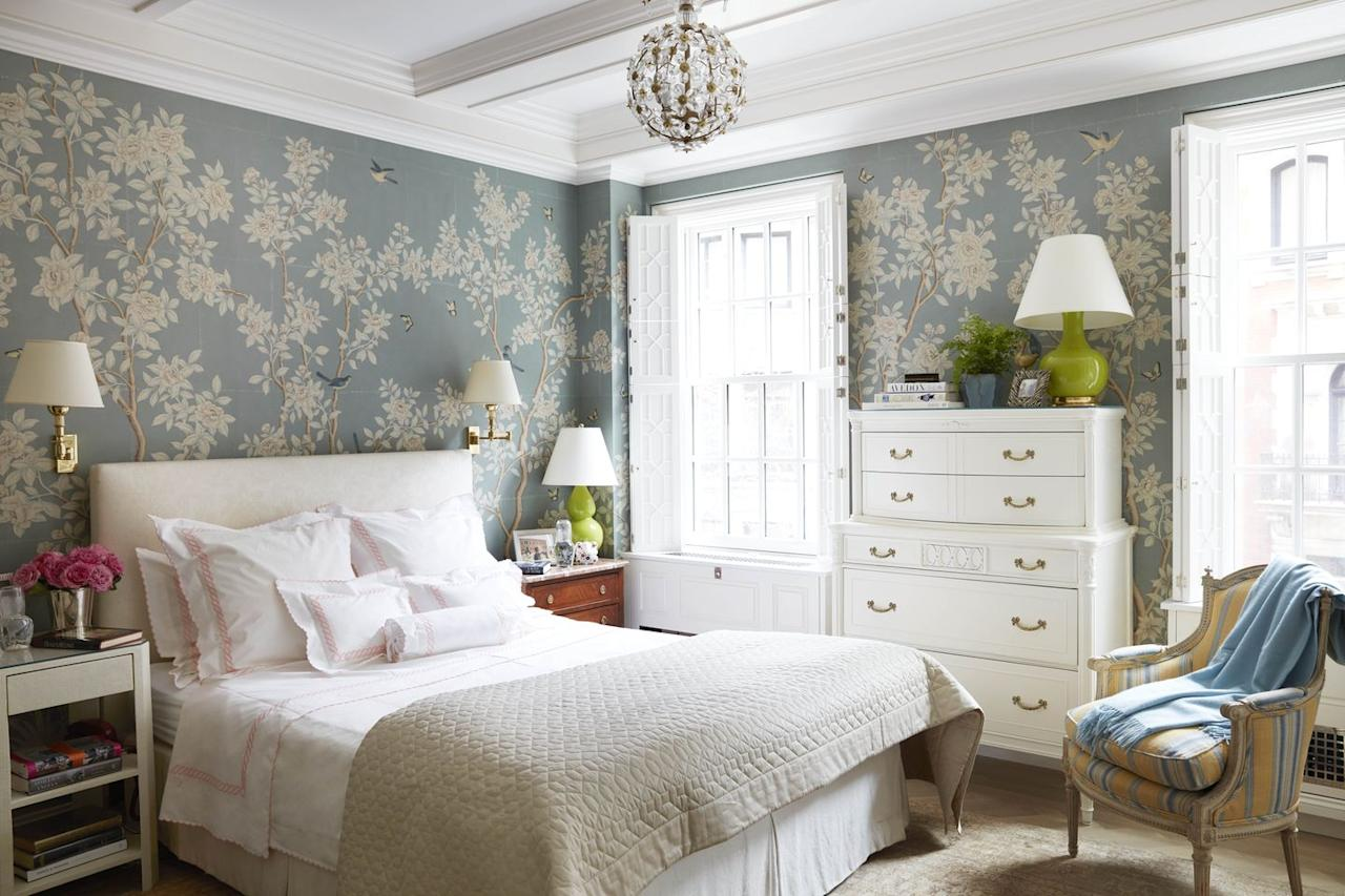 "<p>Historian <a href=""https://maureenfooter.com/"" target=""_blank"">Maureen Footer</a> transforms her New York City bedroom into an enchanted garden with the help of hand-painted <a href=""https://fave.co/2LeKLV0"" target=""_blank"">Gracie</a> wallpaper. Influenced by Christian Dior's timeless blend of old-world style and New Look chic, Footer includes shutters with intricate fretwork and a Louis XVI chair from<a href=""https://fave.co/2ILocox"" target=""_blank""> John Rosselli Antiques</a> for a bit of decorative French flair. The bedding is from <a href=""https://www.casadelbianco.com/"" target=""_blank"">Casa del Bianco</a>. The lamp is <a href=""https://fave.co/2L6bBhX"" target=""_blank"">Christopher Spitzmiller</a> with pendant lighting from<a href=""https://fave.co/2ILoE6d"" target=""_blank""> Chameleon Fine Lighting</a>.</p>"