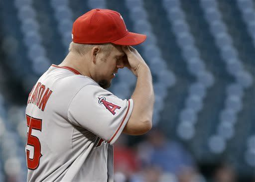 Los Angeles Angels starting pitcher Joe Blanton wipes his brow after Houston Astros' Matt Dominguez advance from second to third on a wild pitch in the third inning of a baseball game Wednesday, May 8, 2013, in Houston. (AP Photo/Pat Sullivan)