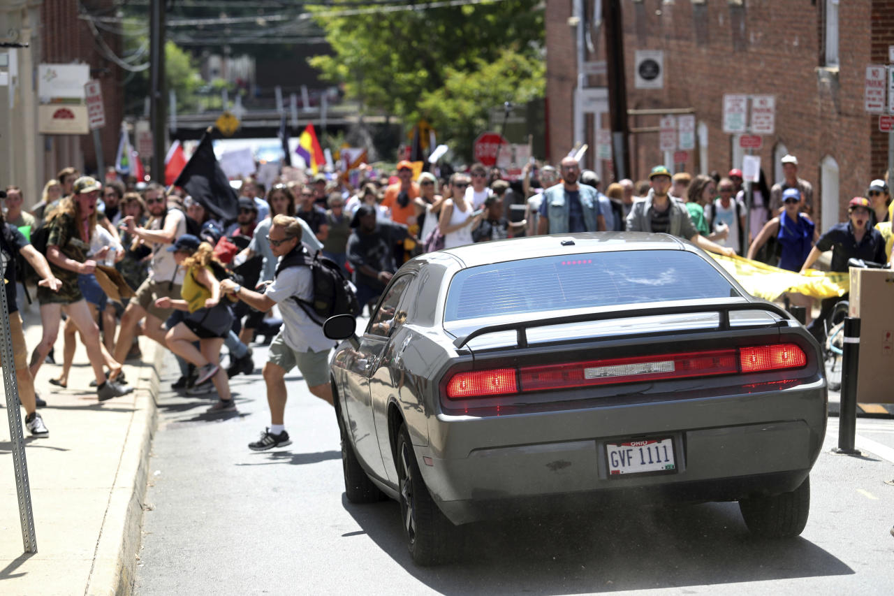 <p>A vehicle drives into a group of protesters demonstrating against a white nationalist rally in Charlottesville, Va., Saturday, Aug. 12, 2017. (Photo: The Daily Progress via AP) </p>