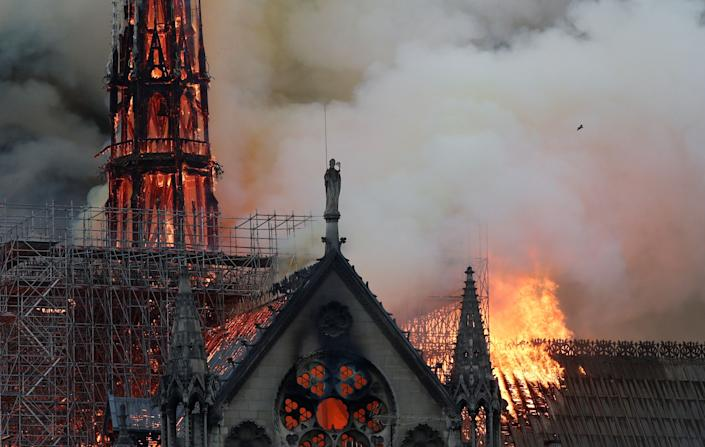 Smoke billows near scaffolding as fire engulfs the spire of Notre Dame Cathedral in Paris, France April 15, 2019. (Photo: Benoit Tessier/Reuters)