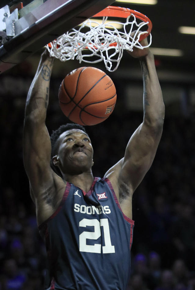 Oklahoma forward Kristian Doolittle (21) dunks during the first half of an NCAA college basketball game against Kansas State in Manhattan, Kan., Saturday, March 9, 2019. (AP Photo/Orlin Wagner)