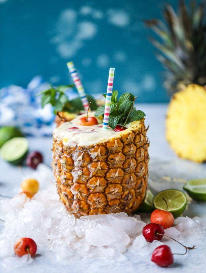 """<p>When your drink looks as enticing as this non-alcoholic frozen concoction does, you'll never miss the rum. </p><p>Get the <a href=""""https://www.howsweeteats.com/2017/07/pina-colada-mocktails/"""" rel=""""nofollow noopener"""" target=""""_blank"""" data-ylk=""""slk:recipe"""" class=""""link rapid-noclick-resp"""">recipe</a>.</p>"""