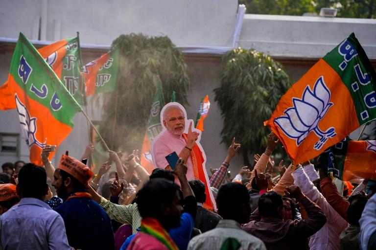 "<p>Supporters of India's Bhartiya Janata Party (BJP) hold a cutout of India's Prime Minister Narendra Modi as they celebrate elections results at the party headquarters in New Delhi on March 11, 2017.<br /> Prime Minister Narendra Modi's Bharatiya Janata Party claimed election victory in four Indian states, calling it a ""historic mandate"" that would take the country's politics in a new direction. </p>"