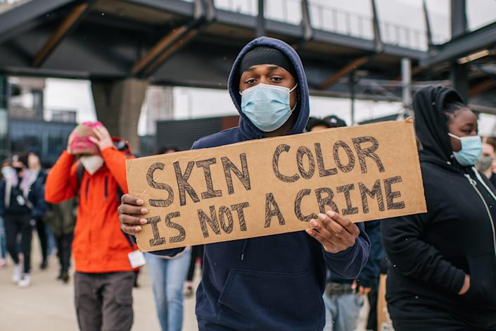 Students from Roosevelt High School participate in a statewide walkout April 19 in Minneapolis. Students gathered at the U.S. Bank Stadium to protest racial injustice and honor the lives of George Floyd and Daunte Wright.