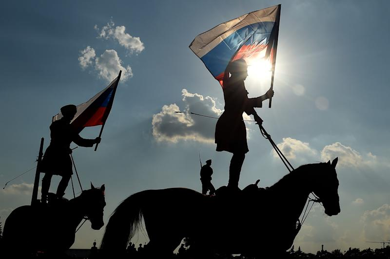 <p>Riders hold the Russian national flag in Moscow on August 22, 2016, during celebrations of the National Flag Day. Russia marks the 25th anniversary of the abortive 1991 coup against then Soviet president Mikhail Gorbachev. August 22, 1991, when Russia's flag was raised atop the Russian White House instead of the Soviet one was declared as Russia's Flag Day. Photo – Getty </p>