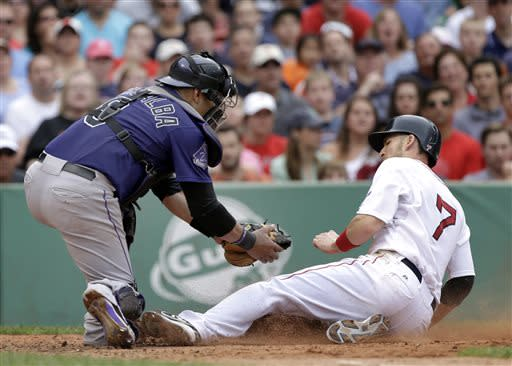 Boston Red Sox's Stephen Drew (7) is tagged out at the plate by Colorado Rockies catcher Yorvit Torrealba as he tries to score on a fielder's choice during the sixth inning of an interleague baseball game at Fenway Park in Boston, Wednesday, June 26, 2013. (AP Photo/Elise Amendola)