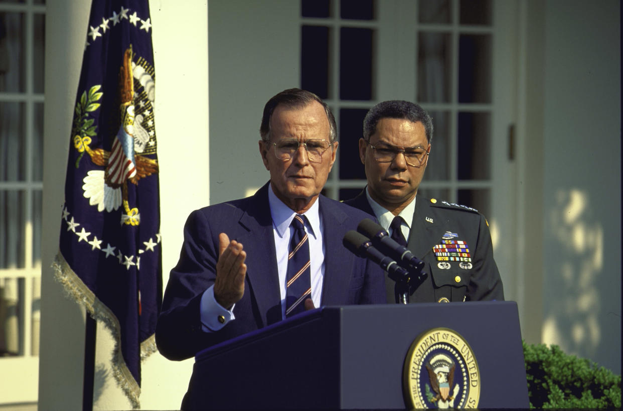 President George H.W. Bush announces the reappointment of Colin Powell, right, as chairman of the Joint Chiefs of Staff in 1991. (Photo: Diana Walker/Time Life Pictures/Getty Images)