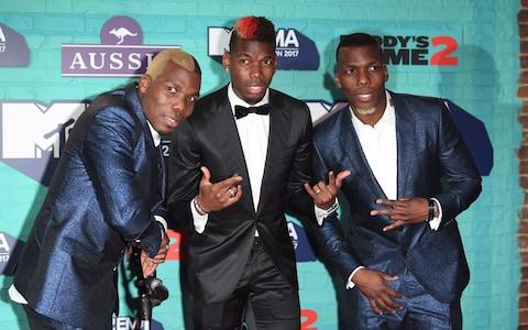 Manchester United's Paul Pogba (C) and his brothers Florentin Pogba (L) and Mathias Pogba (R) attend the MTV EMAs 2017 - Credit: WIREIMAGE