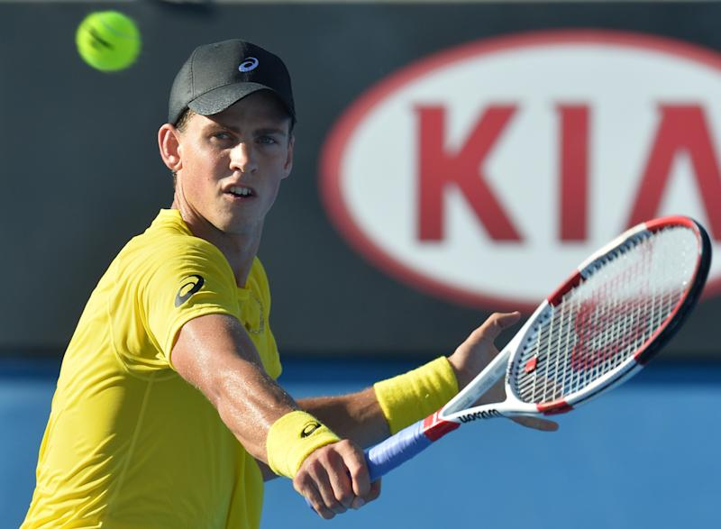Canada's Vasek Pospisil plays a shot against Australia's Samuel Groth during their men's singles match on day one of the 2014 Australian Open tennis tournament in Melbourne on January 13, 2014