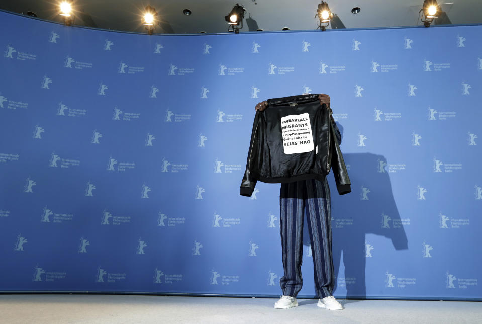 Actor Welket Bungue poses for the photographers during a photo call for the film 'Berlin Alexanderplatz' at the 70th International Film Festival, Berlinale, in Berlin, Germany, Wednesday, Feb. 26, 2020. (AP Photo/Michael Sohn)