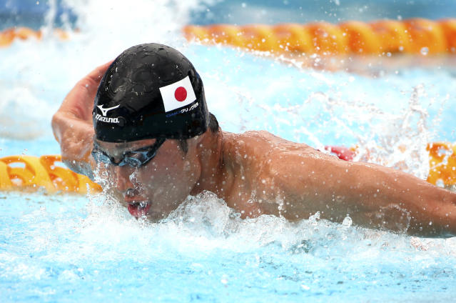 Kosuke Hagino of Japan swims butterfly during his men's 200m individual medley at the Pan Pacific swimming championships in Gold Coast, Australia, Sunday, Aug. 24, 2014. (AP Photo/Rick Rycroft)