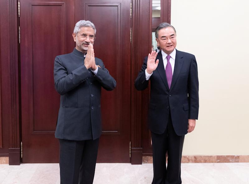 Chinese State Councilor and Foreign Minister Wang Yi meets Indian Foreign Minister SubrahmanyamJaishankar on the sidelines of the Shanghai Cooperation Organisation meeting in Moscow, Russia September 10, 2020. Picture taken September 10, 2020. China Daily via REUTERS ATTENTION EDITORS - THIS IMAGE WAS PROVIDED BY A THIRD PARTY. CHINA OUT.