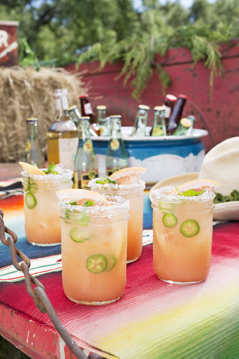 """<p>Homemade jalapeño tequila sets this grapefruit margarita apart from the rest.</p><p><strong><a href=""""https://www.countryliving.com/food-drinks/recipes/a45485/grapefruit-ranch-water-recipe/"""" rel=""""nofollow noopener"""" target=""""_blank"""" data-ylk=""""slk:Get the recipe"""" class=""""link rapid-noclick-resp"""">Get the recipe</a>.</strong></p><p><strong><strong><a class=""""link rapid-noclick-resp"""" href=""""https://www.amazon.com/Purefold-Inches-Cocktail-Stainless-Pattern/dp/B01IVSWTBK/?tag=syn-yahoo-20&ascsubtag=%5Bartid%7C10050.g.30433150%5Bsrc%7Cyahoo-us"""" rel=""""nofollow noopener"""" target=""""_blank"""" data-ylk=""""slk:SHOP COCKTAIL MIXING SPOONS"""">SHOP COCKTAIL MIXING SPOONS</a></strong><br></strong></p>"""