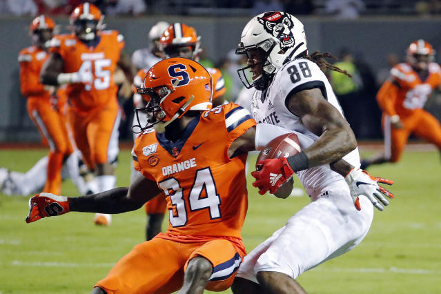 North Carolina State's Devin Carter (88) makes a catch next to Syracuse's Eric Coley (34) during the first half of an NCAA college football game in Raleigh, N.C., Thursday, Oct. 10, 2019. (AP Photo/Karl B DeBlaker)